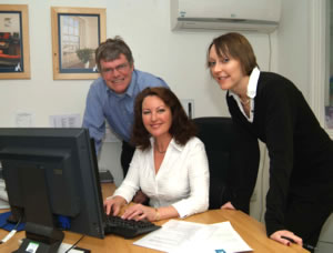 Watched by Roger Graffy, owner of Mylor Yacht Harbour, Cora Gollop and Angela Sims acquaint themselves with the new PacsoftMMS Marina Management System.